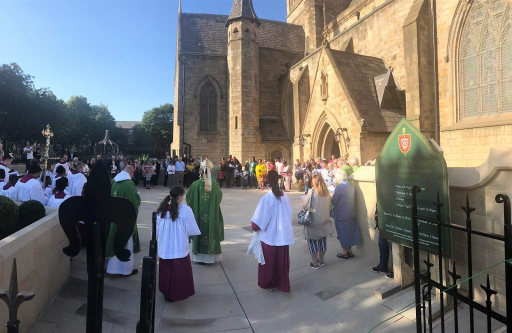 Bishop John with parishioners at the blessing of the Piazza